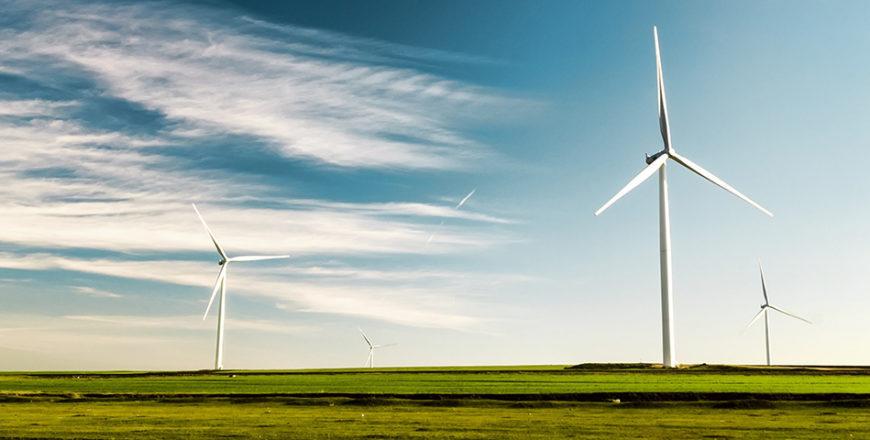 Windmills in a field.
